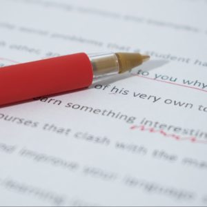 red pen with editing markup