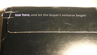 "envelope with tear strip marked ""let the buyer's remorse begin"""